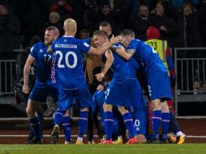 Iceland players celebrate after beating Kosovo to book their place at the 2018 World Cup