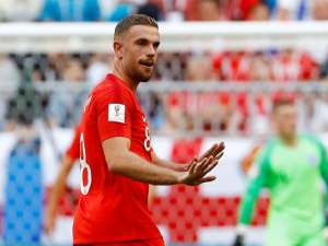England's Jordan Henderson gestures in the match against Sweden on July 7, 2018