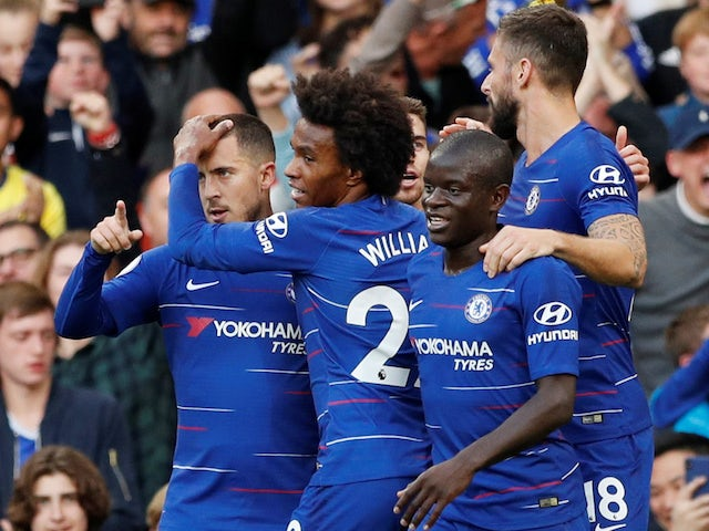 Chelsea's Eden Hazard celebrates with teammates after scoring against Liverpool during their Premier League clash on September 29, 2018