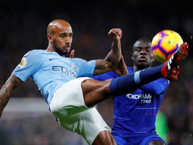 Fabian Delph and N'Golo Kante in action during the Premier League game between Chelsea and Manchester City on December 8, 2018