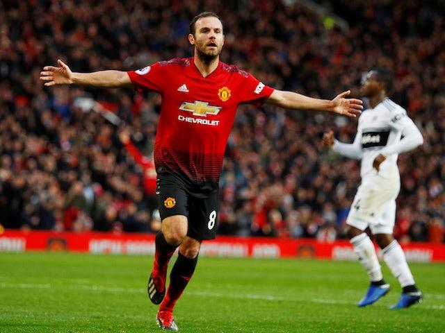 Manchester United's Juan Mata celebrates after scoring against Fulham on December 8, 2018