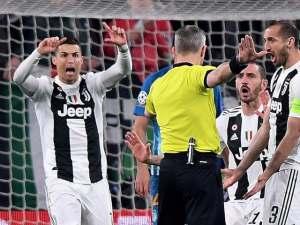Cristiano Ronaldo and Giorgio Chiellini dispute a disallowed goal against Atletico Madrid in the Champions League on March 12, 2019.