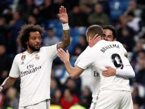 Marcelo joins in the celebrations with Real Madrid teammate Karim Benzema following the French striker's goal against Huesca on Mach 31, 2019