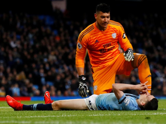 Manchester City's Phil Foden reacts as Cardiff City's Neil Etheridge looks on during their Premier League clash on April 3, 2019