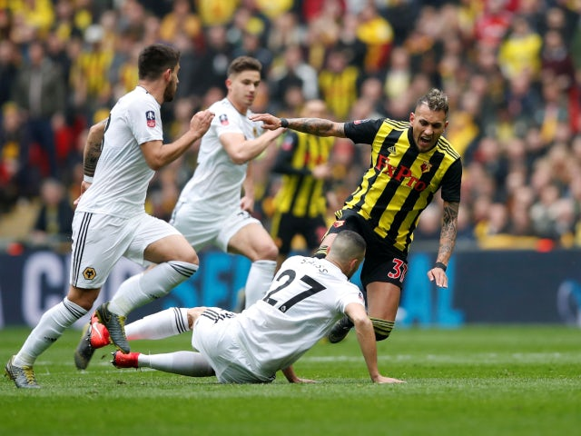Watford's Roberto Pereyra in action with Wolverhampton Wanderers' Romain Saiss on April 7, 2019