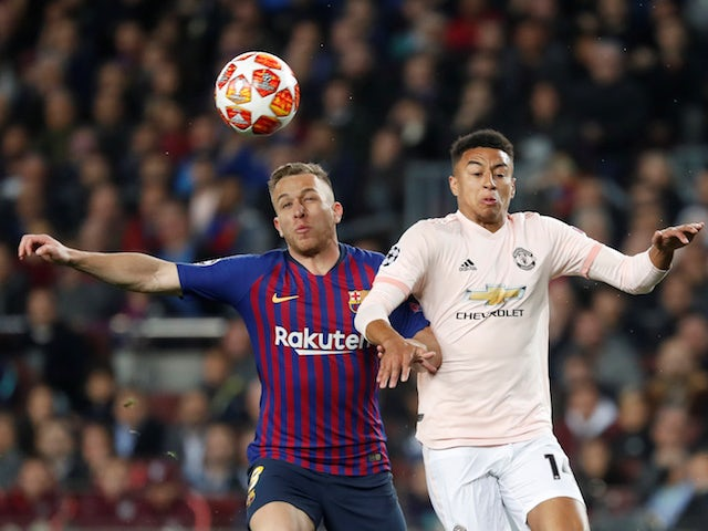 Barcelona's Arthur and Manchester United's Jesse Lingard battle for the ball in the Champions League on April 16, 2019