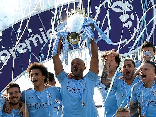 Manchester City captain Vincent Kompany lifts the 2018-19 Premier League trophy