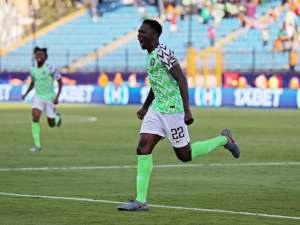 Nigeria's Kenneth Omeruo celebrates scoring against Guinea on June 26, 2019