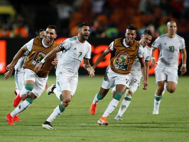 Algeria's Riyad Mahrez celebrates scoring their second goal against Nigeria with teammates on July 14, 2019