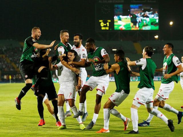 Tunisia's Youssef Msakni celebrates scoring their second goal with team mates on June 11, 2019