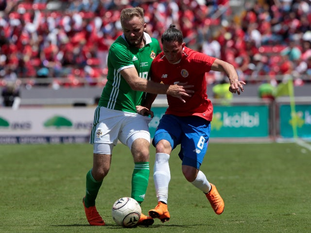 Costa Rica's Bryan Oviedo in action with Northern Ireland's Ryan McLaughlin in June 2018