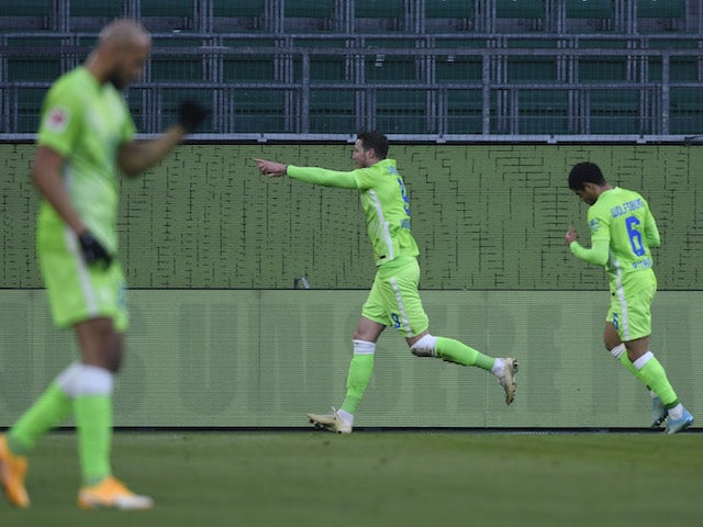 VfL Wolfsburg's Wout Weghorst celebrates scoring their first goal with Paulo Otavio on January 16, 2021