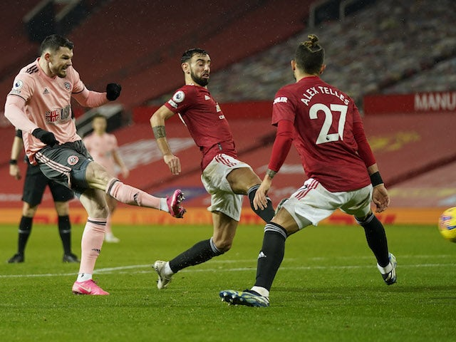 Sheffield United's Oliver Burke scores against Manchester United in the Premier League on January 27, 2021