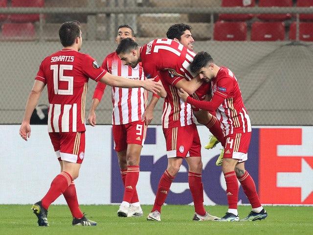 Olympiacos' Giorgos Masouras celebrates scoring their fourth goal with teammates in the Europa League on February 18, 2021