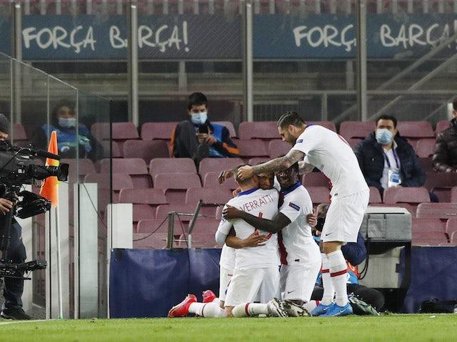 Paris Saint-Germain's Kylian Mbappe celebrates scoring their first goal with teammates on February 16, 2021