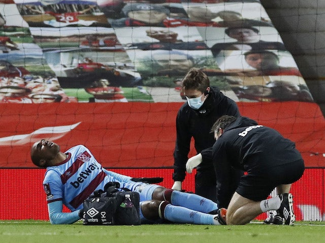 West Ham United's Angelo Ogbonna is treated by medical staff after sustaining an injury in February 2021