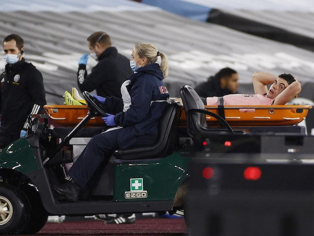 Sheffield United's John Egan is stretchered off after sustaining an injury in February 2021