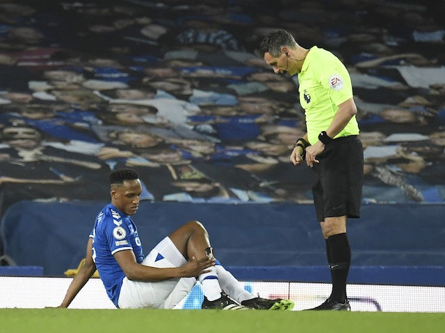 Yerry Mina reacts after sustaining an injury in February 2021