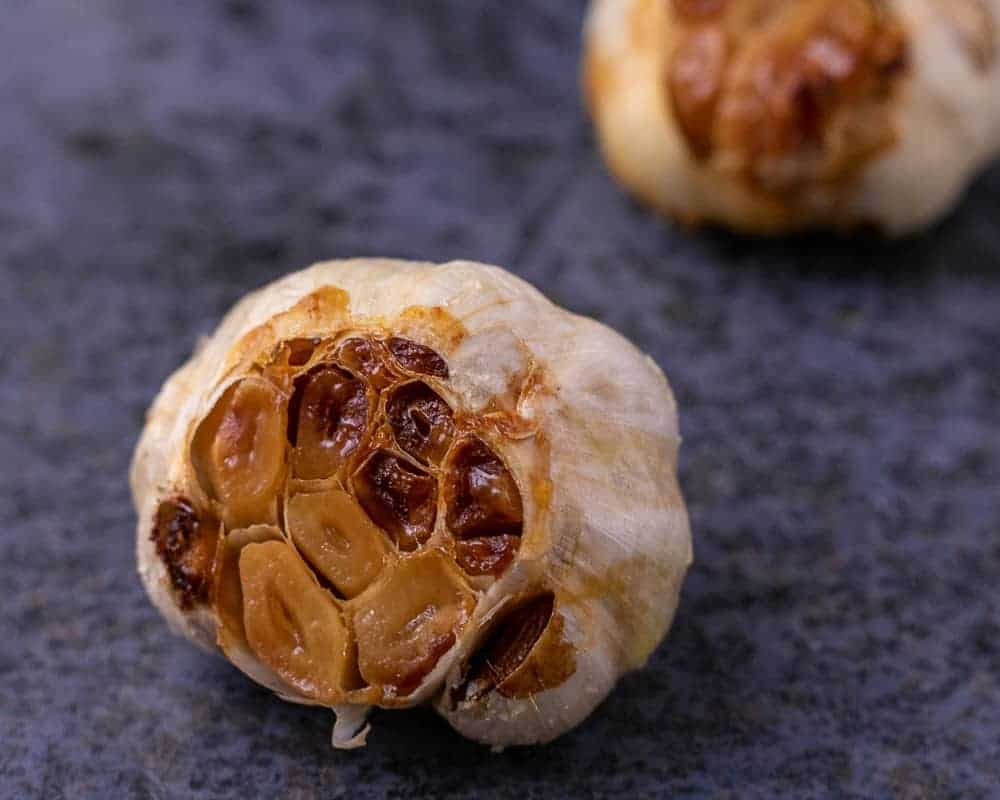 A close up of a head of roasted garlic