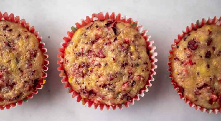 Close up of three cranberry orange muffins