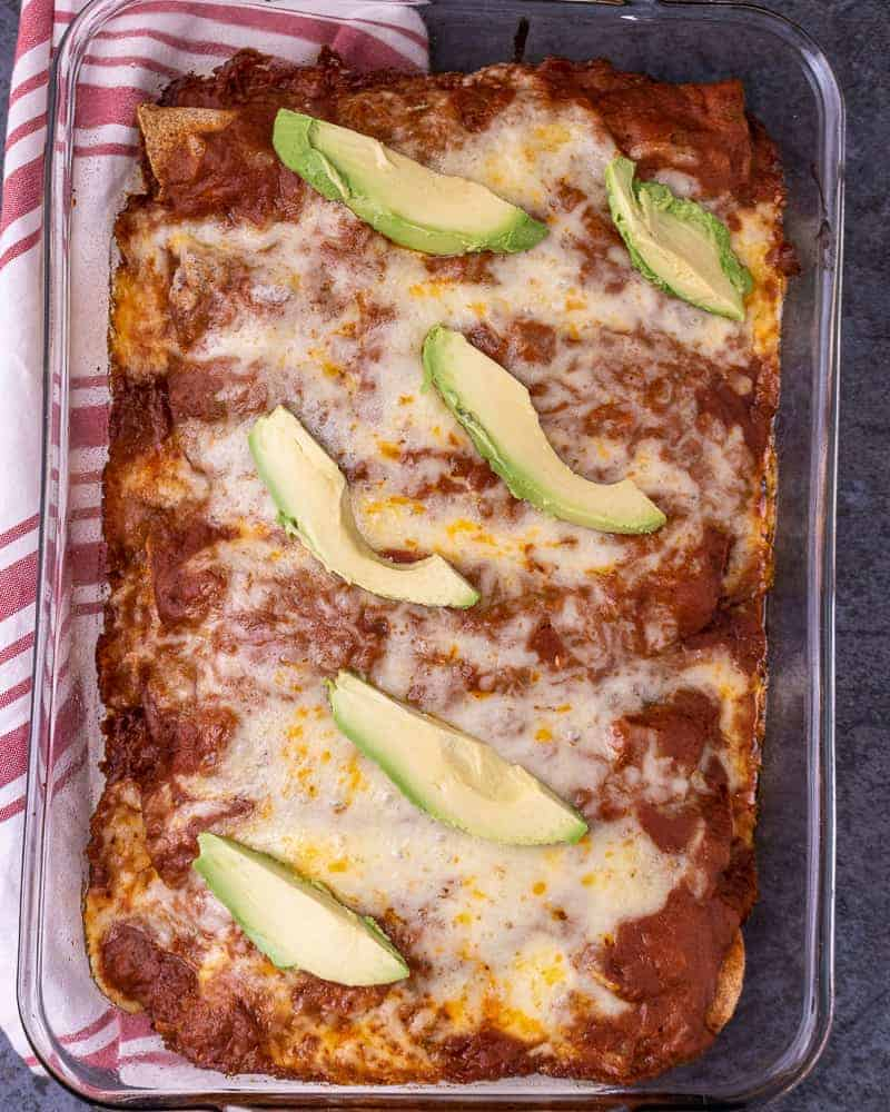 Close up of a plate of chicken enchiladas in the pan