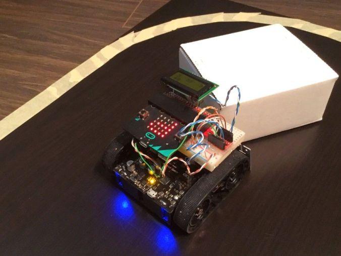 Safe SumoBot Pushing a Box