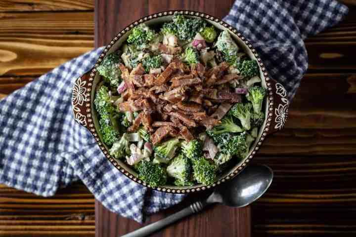 bowl of sugar free broccoli salad with bacon on top