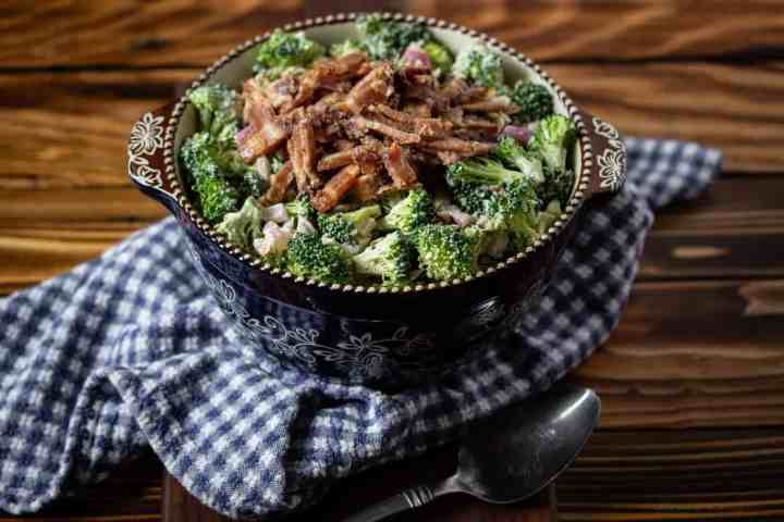 bowl of sugar free broccoli salad with bacon on top
