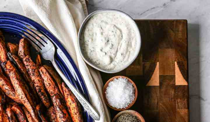 small bowl of gluten free homemade ranch dip with air fryer sweet potato wedges