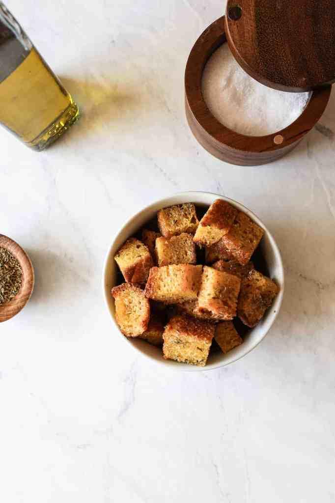 a bowl of gluten free sourdough croutons