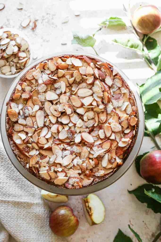 an overhead photo of gluten free apple almond cake with sliced almonds on top