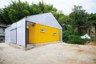 This low-cost shipping container house is covered by a tent-like polycarbonate structure to create semi-outdoor spaces between and around the containers.   www.facebook.com/SmallHouseBliss