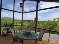 A modern cabin in the hills of North Carolina. It has one bedroom on the 704 sq ft ground floor plus a loft. | www.facebook.com/SmallHouseBliss