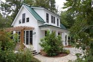 "This traditional ""Katrina Cottage"" design has 3 bedrooms in 1,112 sq ft. 