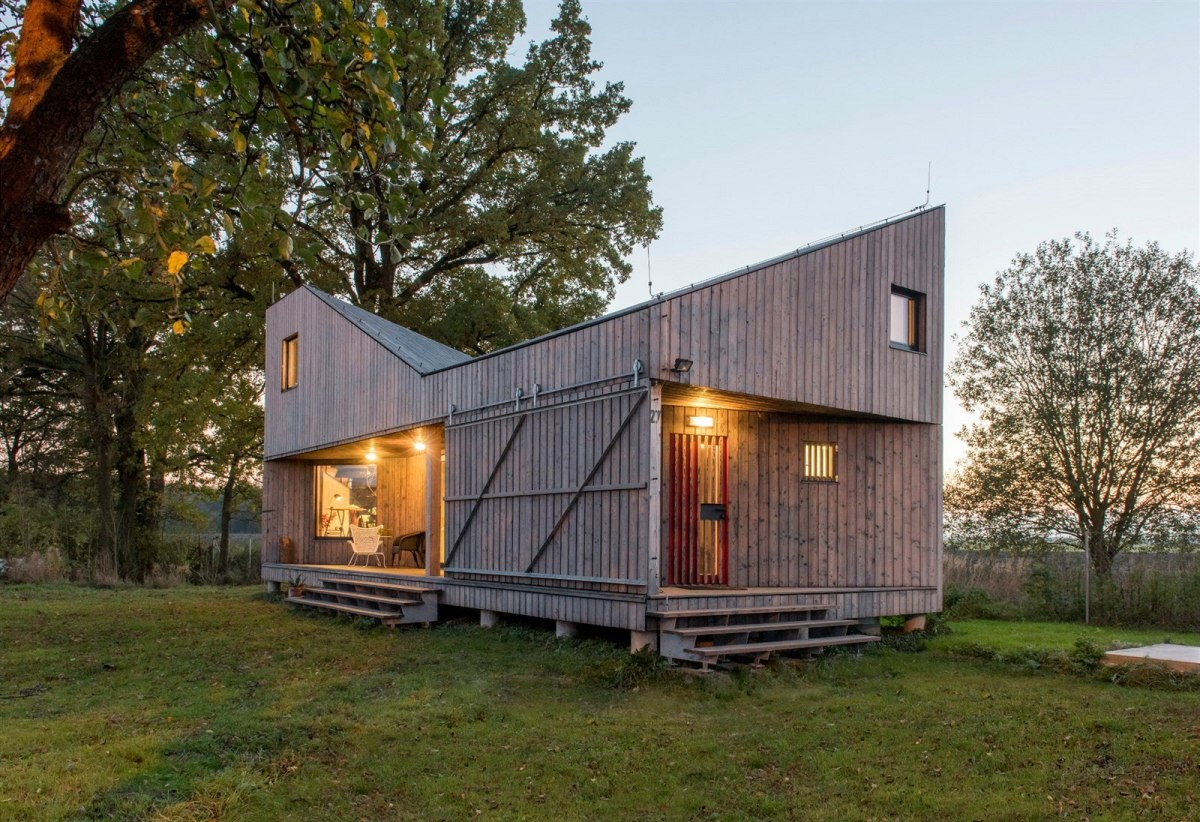 Energy-efficient Home With Folded Roof Asgk Design