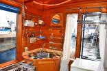 """Tao"", a tiny houseboat on Seattle's Lake Union. Tao has roughly 260 sq ft of inside space plus a sleeping loft. 