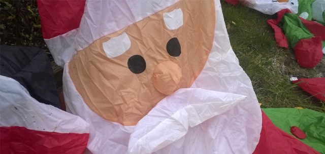 Deflated Santa Lawn Decoration