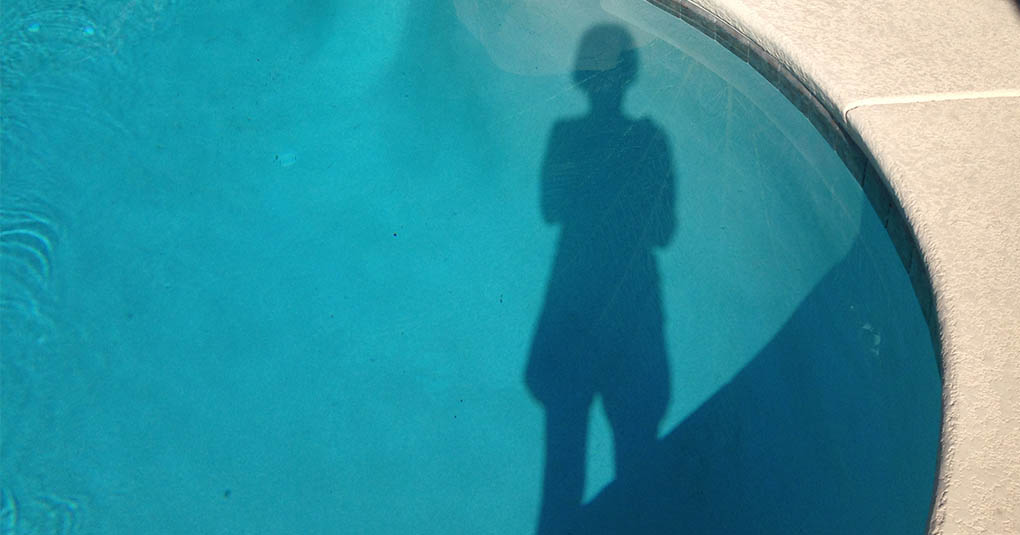 Shadow in a Swimming Pool. Happy Summer