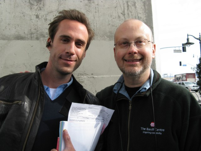 Joseph Fiennes and Robert J. Sawyer on location in Los Angeles shooting the ABC series FlashForward, which was based on Sawyer's novel of the same name. Sawyer served as consultant and Fiennes played Mark Benford in the series. Photo by Carolyn Clink.