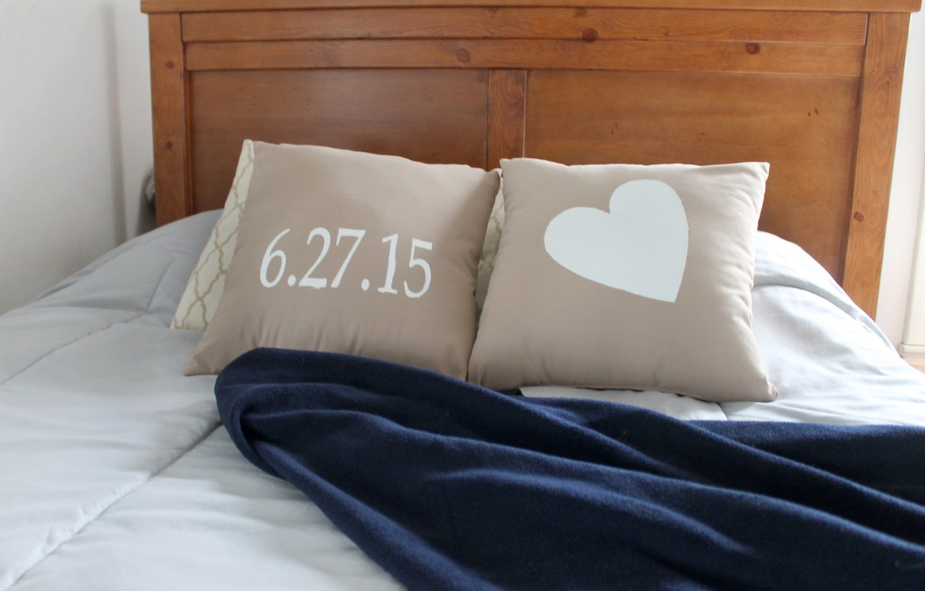Image of DIY wedding date pillows stenciled with the Silhouette