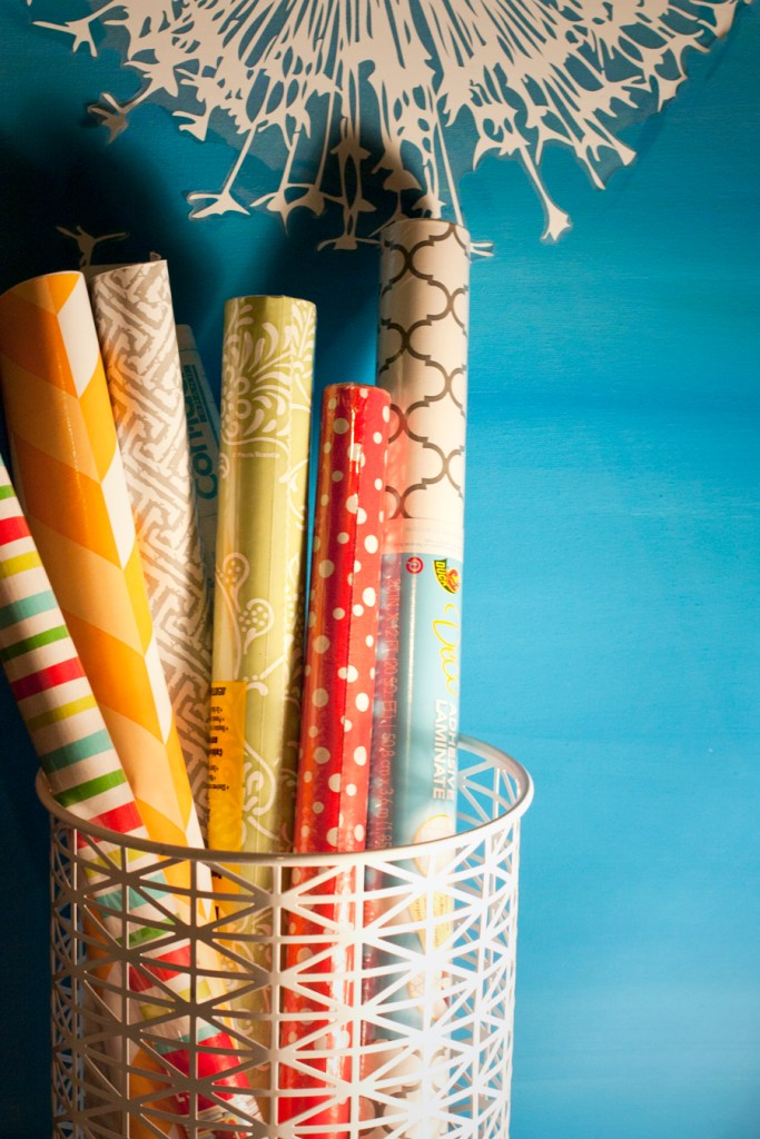 Store your wrapping paper rolls in a bin so they're easy to access and see what you have. Simple and pretty!