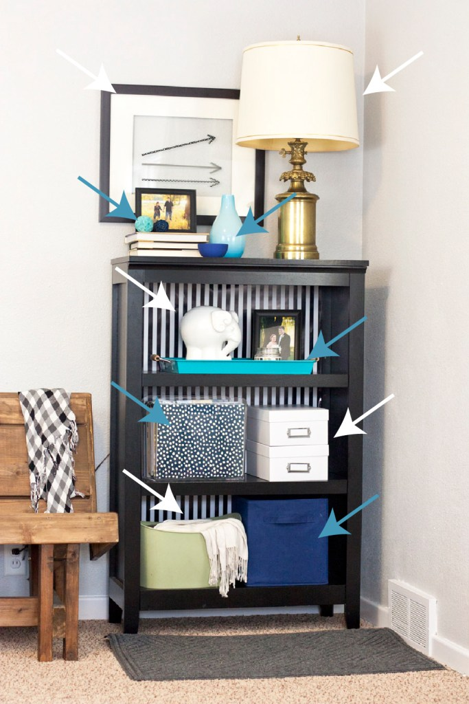 Good advice for styling a bookshelf by repeating colors and spreading them evenly throughout the design. Such a good interior styling tip to remember.