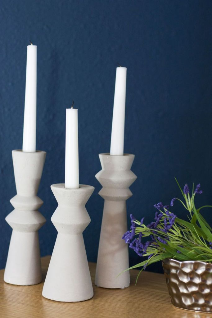 These are amazing concrete candlestick holders! How beautiful for this navy bedroom makeover. One Room Challenge.
