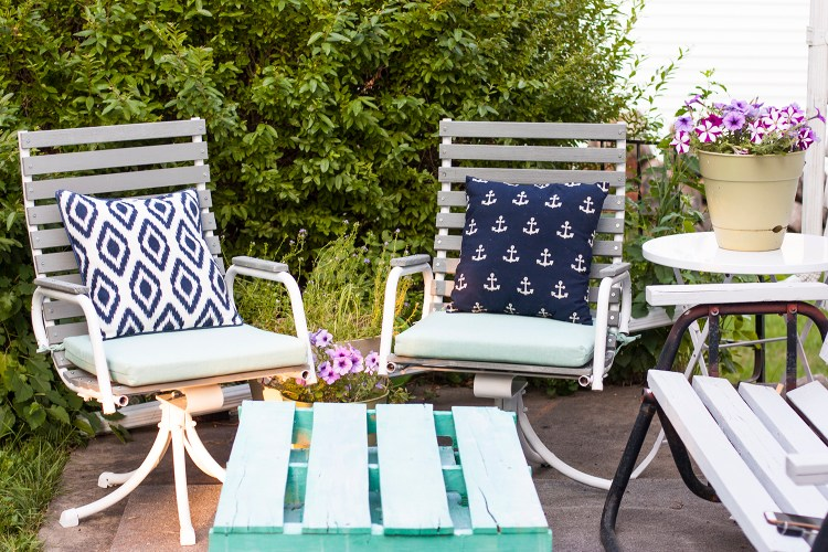 Need to refinish old wooden patio chairs? See how this blogger transformed a pair of garage sale finds on a small budget. I am constantly amazed at what some new paint can do!