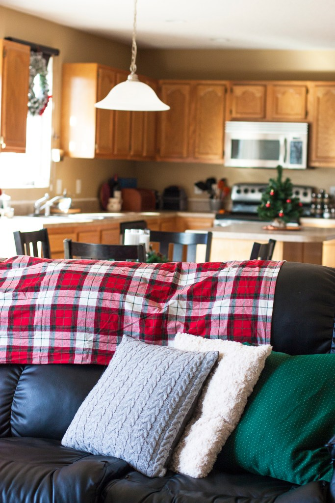 What a pretty blogger home tour! I love the red plaid Christmas decor in this builder grade house. christmas home tour | holiday homes | christmas house | christmas tree pictures | christmas mantel | christmas living room | christmas blog home tour
