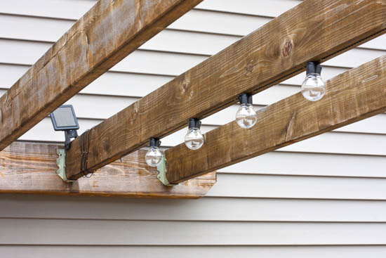 solar-deck-lights-hung-on-pergola