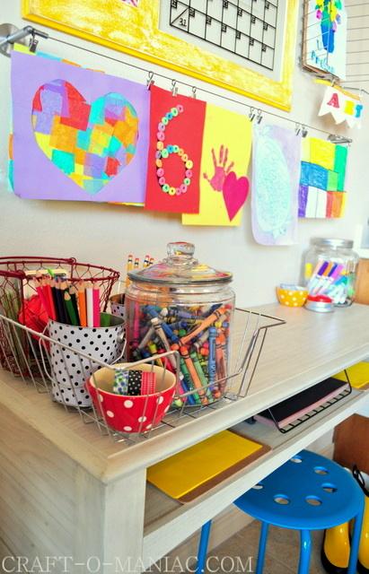 kids art hanging above homework station