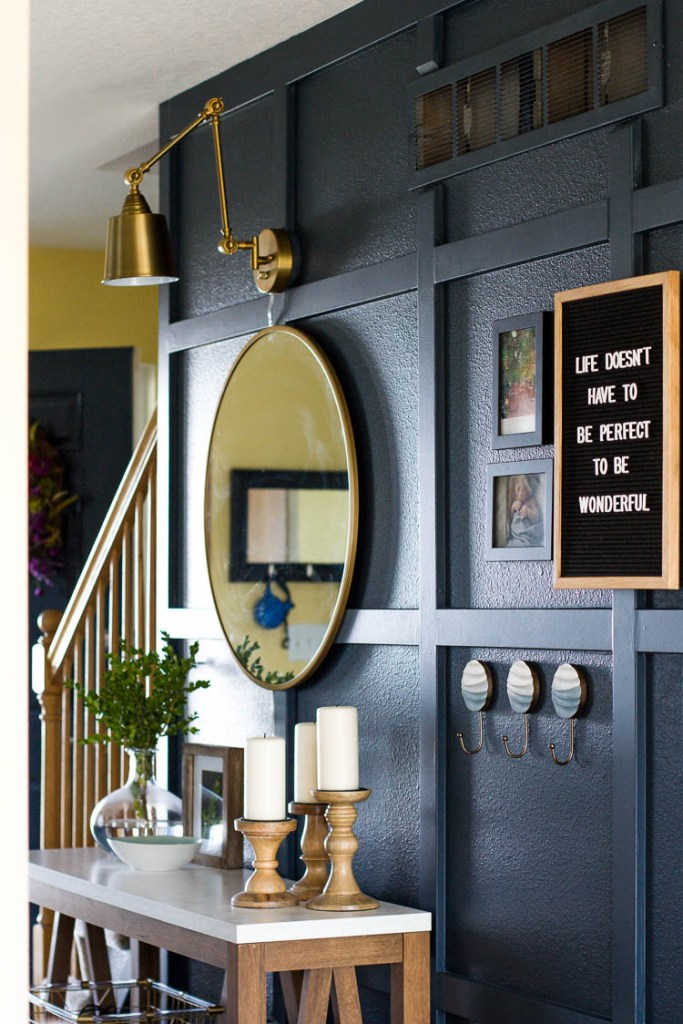 wall-hooks-and-letterboard-in-navy-entryway