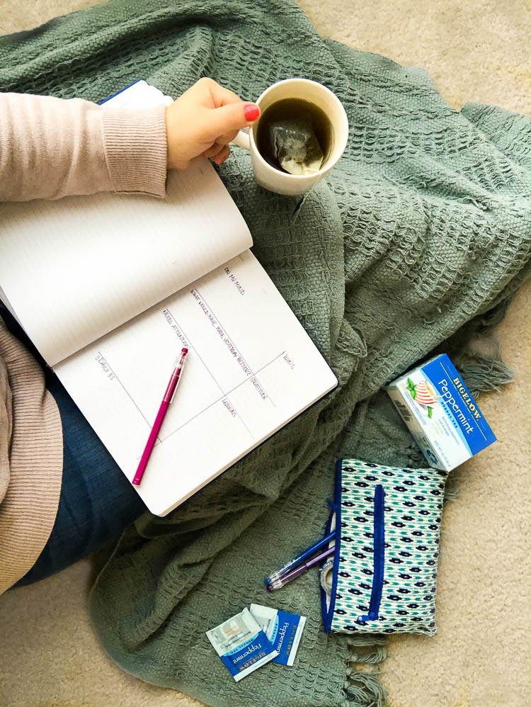 girl-journaling-in-notebook-with-tea