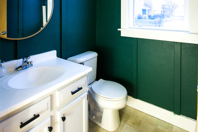 bathroom progress painted organized vanity and a mirror